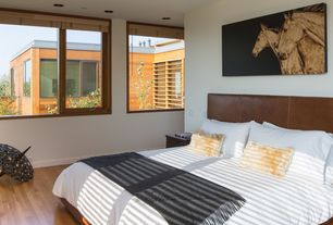 Contemporary Master Bedroom with Standard height, Casement, can lights, Hardwood floors