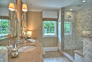 Contemporary Master Bathroom with Travertine counter tops, Wall sconce, Complex Marble, Rain shower, Undermount sink