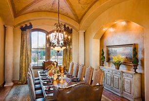 Mediterranean Dining Room with Arched window, Laminate floors, High ceiling, can lights, Columns, Chandelier