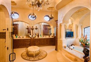 Mediterranean Master Bathroom with Paint, Kitchen Craft, Whittington Solid Cabinet Door Style, Double vanity, drop in bathtub