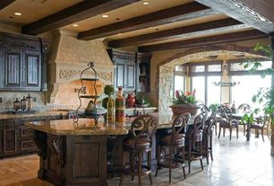 Mediterranean Kitchen with One-wall, Pendant light, Kitchen island, Glass panel, Stone Tile, Custom hood, Breakfast bar