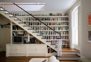 Traditional Staircase with Built-in bookshelf, Under stair storage, Crown molding, Natural light, Hardwood floors, Paint 1