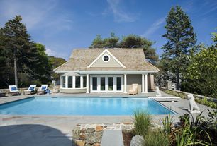 Traditional Swimming Pool with exterior stone floors, French doors, Raised beds