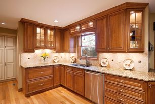 Traditional Kitchen with dishwasher, L-shaped, six panel door, Standard height, can lights, Glass panel, Large Ceramic Tile