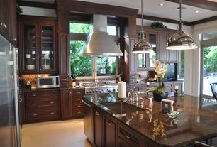 Traditional Kitchen with Glass panel door, L-shaped, Tropical brown granite, Glass panel, Flat panel cabinets, Penny Tile