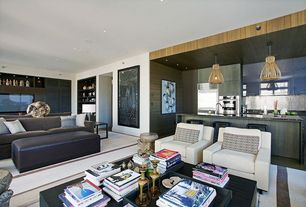 Contemporary Great Room with Concrete floors, Built-in bookshelf