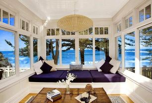 Eclectic Living Room with Box cushion, Woven pendant light, Built in bench seat, Transom window, Ocean view, Paint