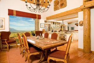 Rustic Dining Room with Chandelier, Hardwood floors, Columns, High ceiling