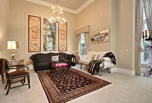 Traditional Living Room with double-hung window, Camelback sofa, Casement, Upholstered cornice with tieback draperies, Carpet