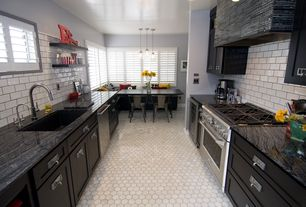 Contemporary Kitchen with Complex granite counters, Custom hood, penny tile floors, White tile with dark grout, Window seat