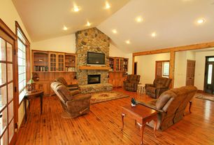 Country Living Room with French doors, River Rock - Faux Stone Panels - Winter Blend, stone fireplace, Built-in bookshelf