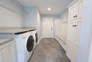 Cottage Laundry Room with Cabinet, Front load washer dryer set, Oil rubbed bronze hardware, Solid surface countertop