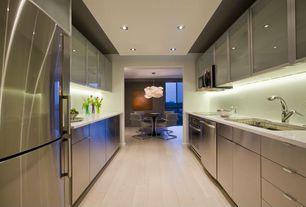 Contemporary Kitchen with Corian- Designer White, Led under cabinet lighting, Glass panel, Flush, Galley, Undermount sink