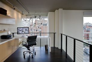 Contemporary Home Office with Design within reach - eames aluminum management chair, flush light, interior brick, Chandelier