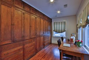 Traditional Home Office with French doors, Crown molding, Hardwood floors
