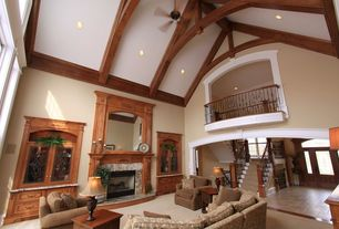 Country Living Room with Cathedral ceiling, Paint 2, stone fireplace, Ceiling fan, Paint, Fireplace, Exposed beam, Loft