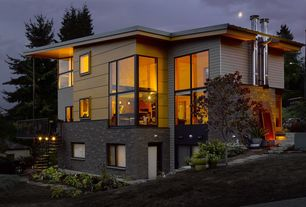 Modern Exterior of Home with Carlton cobblestone faux tall panels