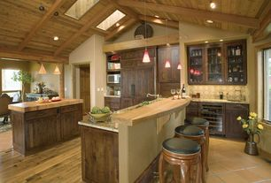 Rustic Kitchen with Glass panel, Wood counters, Limestone Tile, Stone Tile, Simple granite counters, Pendant light, One-wall