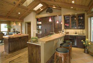 Rustic Kitchen with Breakfast bar, Exposed beam, Kitchen island, terracotta tile floors, Stone Tile, Limestone Tile, Skylight