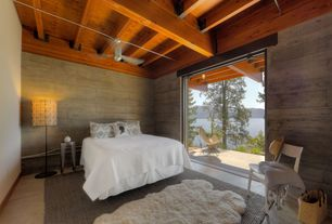 Contemporary Master Bedroom with Exposed beam, slate floors, Ceiling fan, High ceiling, specialty door