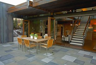 Contemporary Patio with Transom window, Trellis, French doors, exterior stone floors