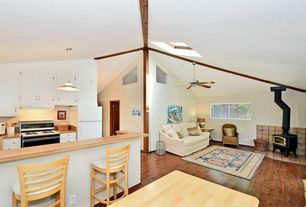 Cottage Great Room with Ceiling fan, Wood Stove fireplace, flush light, Built-in bookshelf, Skylight, Fireplace, Exposed beam