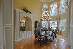 Traditional Dining Room with Cathedral ceiling, Arched window, Chandelier, Paint 1, can lights, Laminate floors
