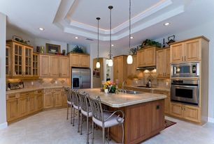 Traditional Kitchen with full backsplash, Pendant light, Large Ceramic Tile, Multiple Sinks, High ceiling, wall oven