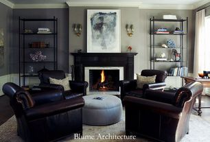 Traditional Living Room with Wall sconce, brick fireplace, Carpet, Built-in bookshelf, Standard height, Fireplace
