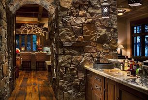 Rustic Bar with High ceiling, Hardwood floors, Pendant light, Natural stone wall, Rustic wood flooring, Built-in bookshelf