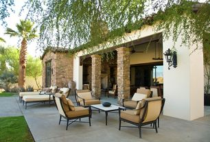 Mediterranean Patio with Stained stucco, Concrete paver slabs