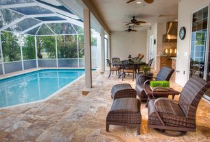 Tropical Patio with exterior stone floors, picture window, Indoor pool, Glass panel door, Outdoor kitchen, sliding glass door