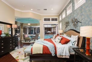 Contemporary Master Bedroom with Built-in bookshelf, Paint, can lights, Upholstered headboard, Ceiling paint, flush light