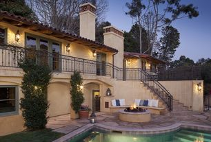 Mediterranean Patio with Deck Railing, exterior stone floors, Gate, Pathway, Fence, Paint 1, French doors, double-hung window