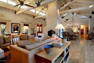 Eclectic Living Room with Ceiling fan, Cement fireplace, High ceiling, Exposed beam, Hardwood floors