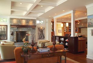 Contemporary Living Room with Crown molding, Fireplace, picture window, Wood console table, Built-in bookshelf, Columns