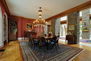 Traditional Dining Room with interior wallpaper, Crown molding, French doors, Hardwood floors, Arched window