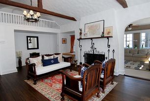 Rustic Living Room with Exposed beam, Hardwood floors, Balcony, Built-in bookshelf, metal fireplace, Standard height