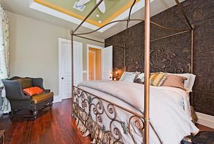 Traditional Guest Bedroom with Ceiling fan, Hardwood floors, interior wallpaper