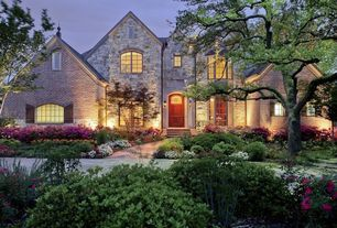 Traditional Exterior of Home with Exterior stone siding, Wall washers lighting, Exterior brick siding