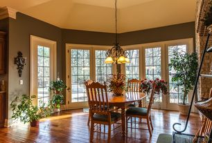 Traditional Dining Room with Standard height, Wall sconce, Hardwood floors, picture window, Chandelier, French doors