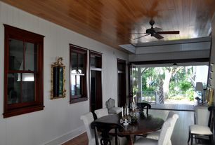Traditional Dining Room with Hardwood floors, Ceiling fan
