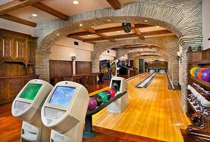 Mediterranean Game Room with Pac man arcade machine, Bowling alley, Paint, Exposed wood beam ceiling, Arcade games