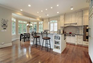 Traditional Kitchen with Crown molding, Simple granite counters, L-shaped, Breakfast bar, Flat panel cabinets, Chandelier