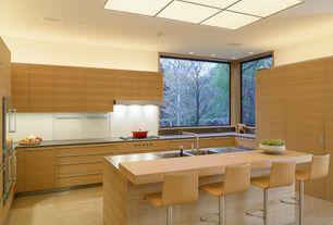 Modern Kitchen with Wood counters, Breakfast bar, Bar height, Full overlay cabinets, European Cabinets, Kitchen island, Flush