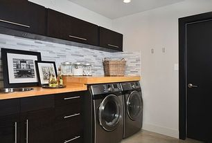 Contemporary Laundry Room with Concrete floors, Built-in bookshelf