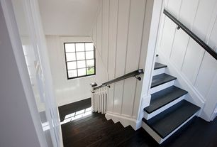Cottage Staircase with Laminate floors, High ceiling, double-hung window, curved staircase