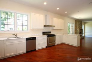 Traditional Kitchen with single dishwasher, Laminate floors, Flat panel cabinets, Wall Hood, Standard height, One-wall