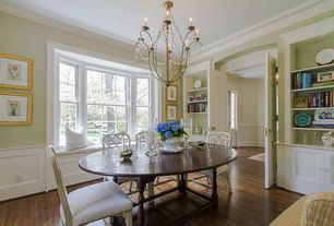 Traditional Dining Room with Built-in bookshelf, Hardwood floors, Wainscotting, Chandelier, Window seat, Crown molding