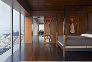 Modern Master Bedroom with Engineered hardwood floors, Modern four poster bed, can lights, Built-in shelving units